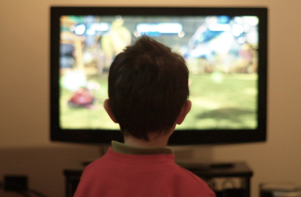 Image of a boy playing video games