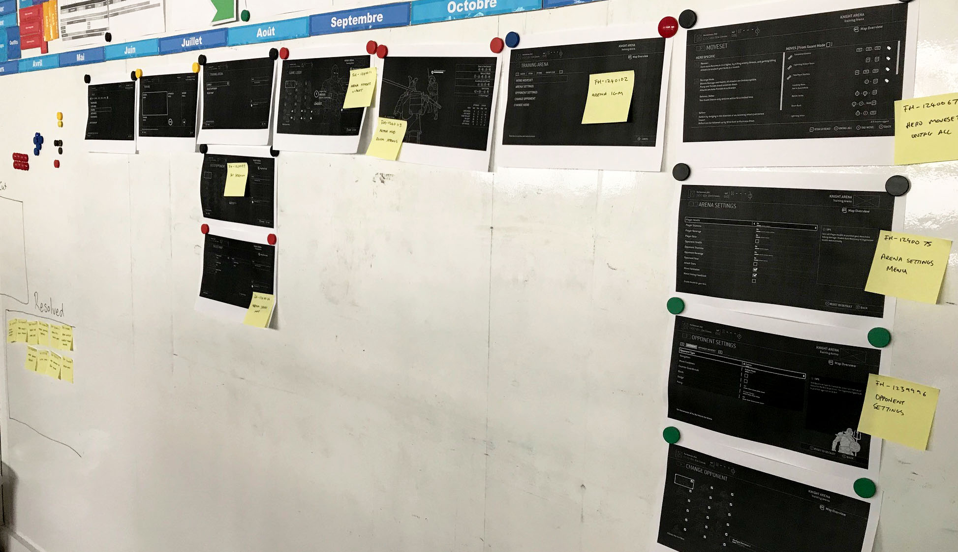 A whiteboard with wireframes attached